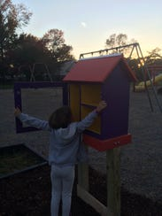 Ellie Zollinger, 7, inspects the recently finished