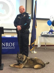 Sgt. James Marlow stands with Bruno, a K-9 officer