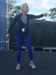 Fitness expert Sydney Benner  leads a morning warmup