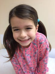 Ella Buss, 7, of Webster, was diagnosed with Lyme disease.