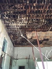 The wooden interior of the Miller-Roy Building is rotting