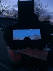The goggles are connected to the drone's camera, creating