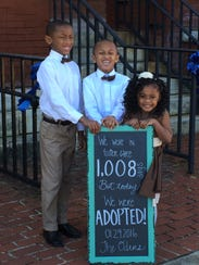 Richard and Brittany Oden's adopted children stand