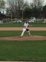Port Clinton's Trevor Monk throws a pitch Monday.