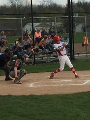 Port Clinton's Noah Smith makes contact Monday.