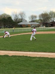 Port Clinton's Seth Monk fields a ground ball at third