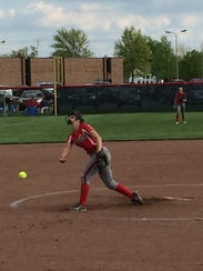 Oak Harbor's Emma Bergman throws a pitch Friday.
