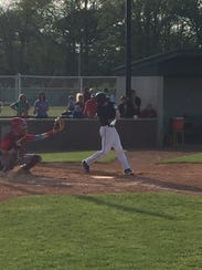 Woodmore's JT Atkin swings at a pitch last week on