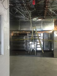 An asbestos abatement crew was on the scene Friday