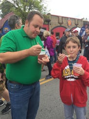 Timmel and Jeremy Heck sample the chili.
