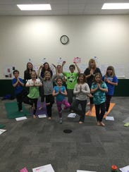 Families can practice yoga together Oct. 15 during