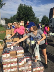 Volunteers filled bags of food items that will be donated