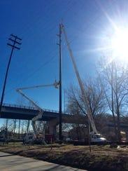 Duke Energy is installing large, new utility poles