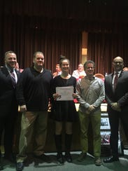 Tess Fisher (center) was honored Wednesday at the Vineland