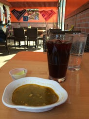 A complementary soup and a Chicha Morada, a traditional