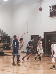 Owego's Christian Sage hits a free throw during the