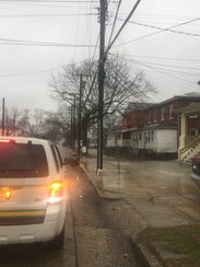 Downed utility lines in the area of Sixth and Quince