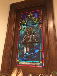 One of the stained-glass windows in St. Mary's newly