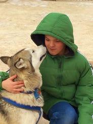 Parkside Elementary School student Aiden Kroll pets
