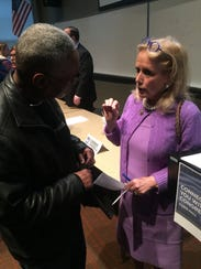 U.S. Rep. Debbie Dingell chats with Detroit resident