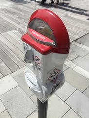 A Know Outlet parking meter on Georgia Street.