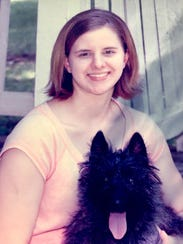 Liz Kurtz at 17 with her dog Maggie a month before