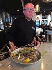 Chef Chip Miller of Blackwall Hitch shows the presentation