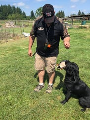 Ranger is seen with waterfowl dog trainer James MacDonald.