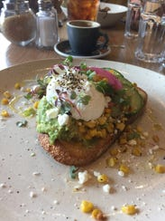 Avocado toast with a poached egg at St. Kilda cafe