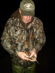 Al Stewart, DNR upland game bird specialist, places