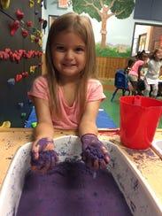 Baylee Nash plays with Slick Sand at The Goddard School
