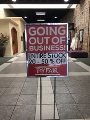A sign for the going out of business sale is seen outside