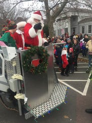 Santa and Mrs. Claus arrived by fire truck at last