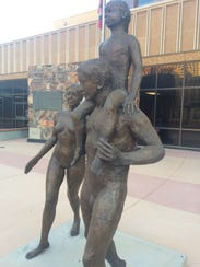 Statues of a family were installed outside the Maricopa