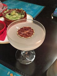 The Eastern Boys Western Girls cocktail contains cardamom