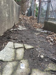 A Wilmington police evidence marker in an alley behind