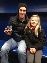 Predators center Kyle Turris poses with Camryn Wallace,