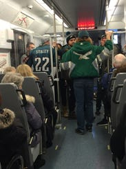 Eagles fans on the PATCO Hi-Speedline headed from South Jersey into Philadelphia on Super Bowl Sunday to watch the game from various sites in the city.
