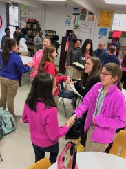 Bryson Middle School seventh-graders practice shaking