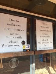 Provence Breads & Cafe has signs posted on the door