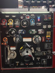 A control panel on the side of HFD's new ladder truck.