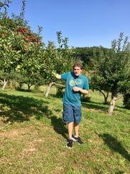Joey L. in September 2017, visiting an apple farm in