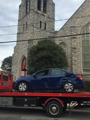 A car towed away in Burlington City on Friday morning