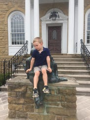 Caedmon Henshaw, 4, took a moment from Saturday's bustle
