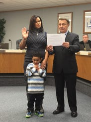 Diamaris Rios takes the oath of office Wednesday evening