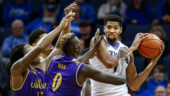 University of Memphis forward Dedric Lawson (right) grabs one of his 14 rebounds against East Carolina University Saturday at FedExForum.