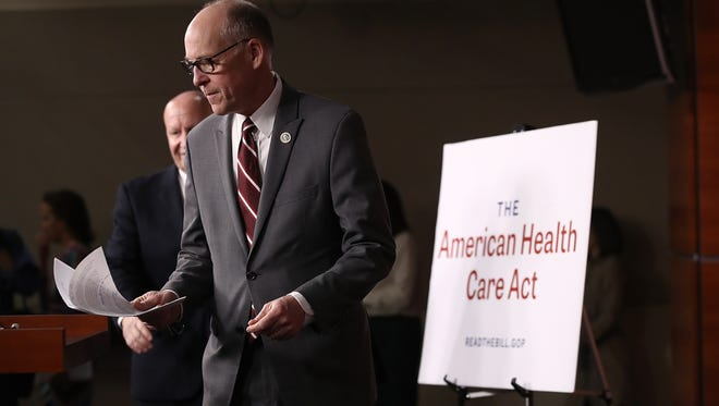 House Energy and Commerce Chairman Greg Walden, R-Ore., and House Ways and Means Chairman Kevin Brady, R-TX, arrive for a news conference on the newly announced American Health Care Act at the U.S. Capitol March 7, 2017 in Washington, DC. House Republicans yesterday released details on their plan to replace the Affordable Care Act, or Obamacare, with a more conservative agenda that includes individual tax credits and grants for states replacing federal insurance subsidies.