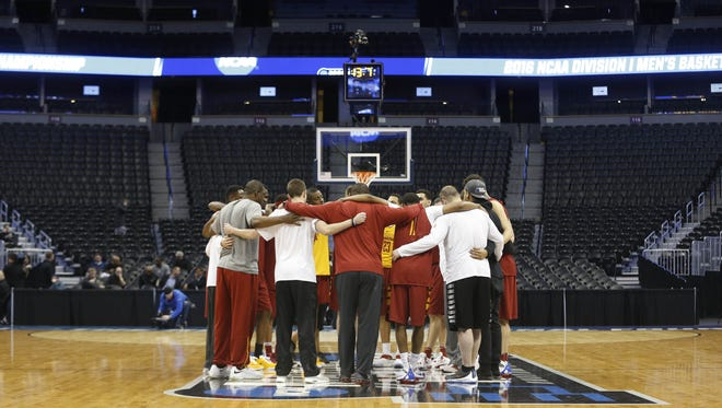 Iowa State players and coaches huddle together Wednesday, March 16, 2016, during practice before the first round of the NCAA basketball tournament at the Pepsi Center in Denver.