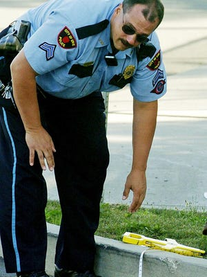 This is an August 2006 file photo of then-Cpl. Jeff Annunziata of the Erie Bureau of Police, on the scene of a traffic accident on Erie's east side.