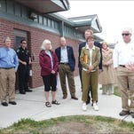Rebecca de Camara, far right, explains Montana Developmental Center issues to the MDC Transition Planning Advisory Committee Thursday as they toured the facility. Included in the group standing outside the MDC's Assessment and Stabilization Unit were MDC Acting Superintendent Tammy Ross, far left, and Department of Public Health Services Director Richard Opper next to her.
